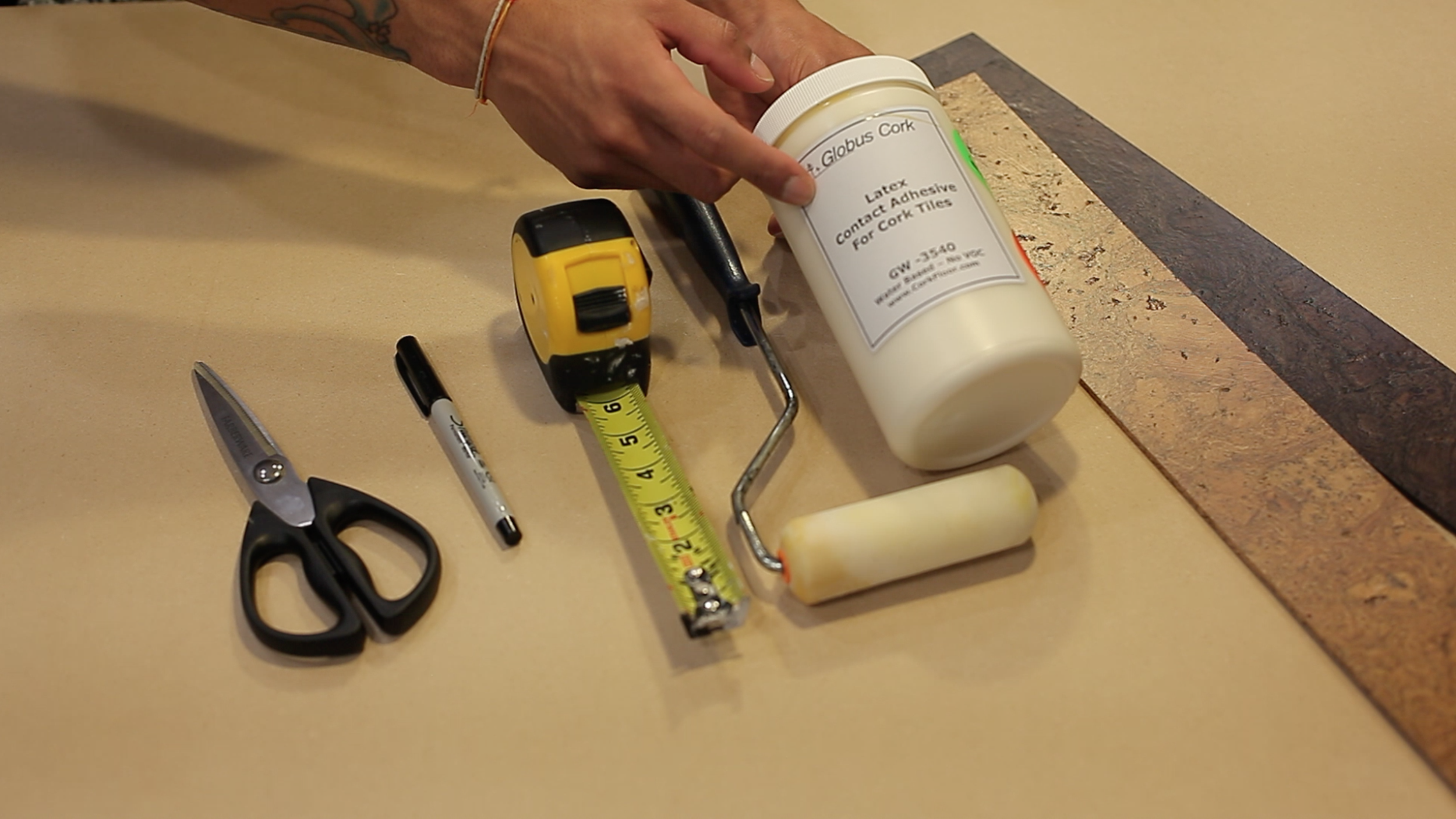 Here are the things you will need...  A good pair of scissors(i used my scissors that i have with my knife set)that will cut through the cork, A pen or sharpie to mark your cuts. Tape measure,paint roller, and the cork adhesive. Don't worry MyCorkFloor.com also carries adhesive.  Lastly, cork color of your choice.  The great thing about MyCorkFloor.com they have several finishes to choose from.  For this project, I've chosen their Smoke and Oak Finish, two beautiful colors that compliments each other.