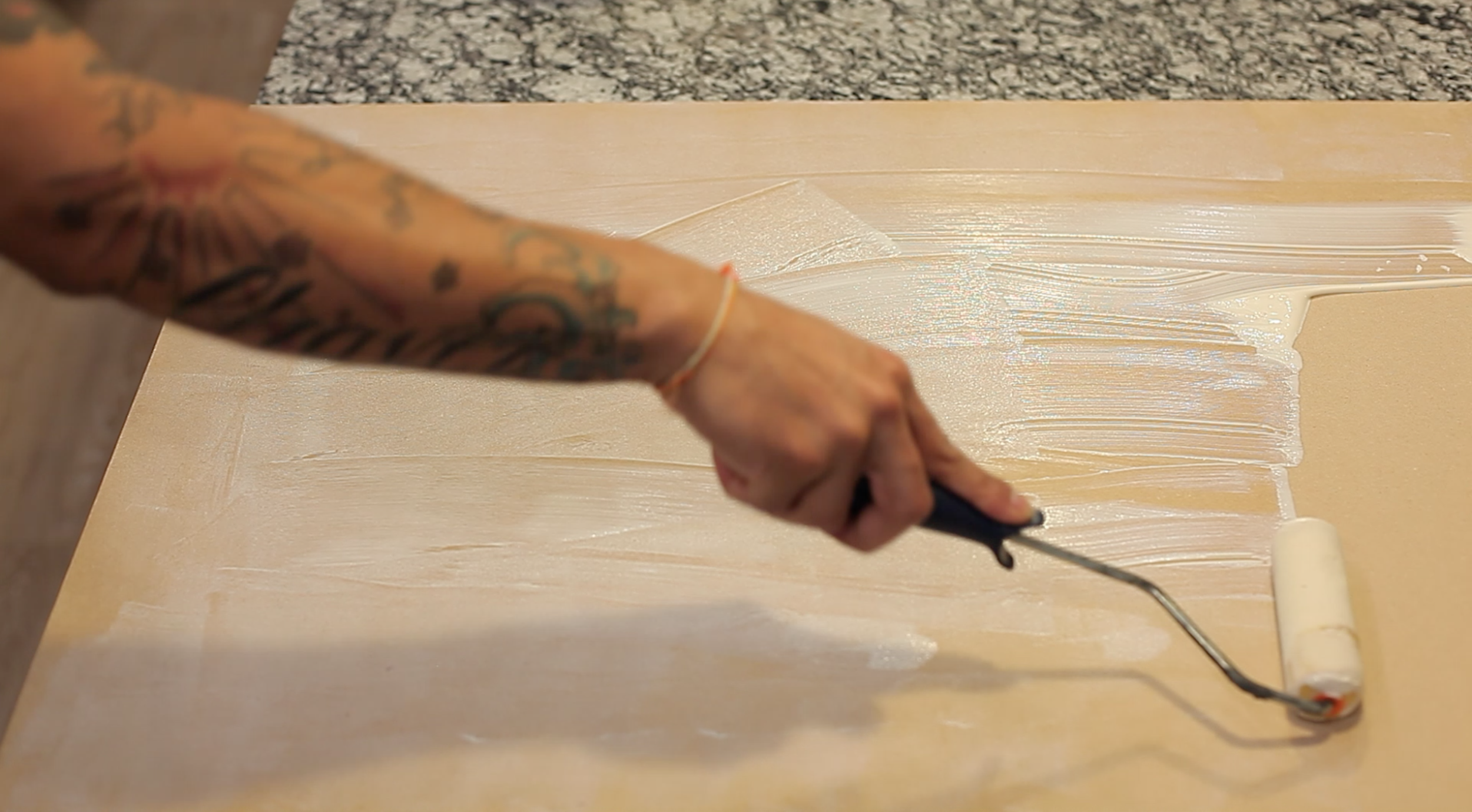 Using your paint roller, apply the adhesive evenly. After applying the adhesive, let it dry for about 3-5minutes. Don't be afraid of the adhesive drying up,It will bond better with the cork.