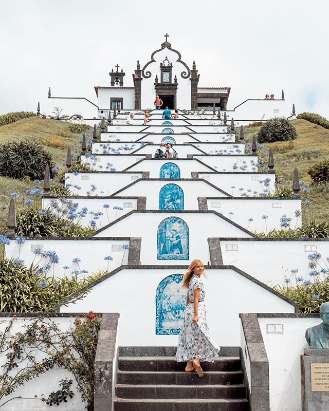 Walking up the steps to the beautiful 'Our Lady of Peace' chapel in São Miguel. ✨ This beautiful chapel had the most stunning panoramic view over Villa Franca Do Campo (the former capital of São Miguel). The steps represents the beads of the rosary and the ten levels represent the Ten Commandments. 💙 . . . . . . #visitazores #visitportugal #darlingescapes #TLPicks #LoveTheWorld  #wonderful_places #dametraveler #exploringtheglobe #fromwhereistand #wearetravelgirls #sheisnotlost #bohopassport #traveldeeper #girlslovetravel #photooftheday #beautifuldestinations #ladiesgoneglobal #exploreportugal #whatiwore #ig_portugal #portugalcomefeitos #weshareportugal #ootd #wewearblack #portuguesechurches #ourladyofpeace #chapel #nossasenhoradapaz