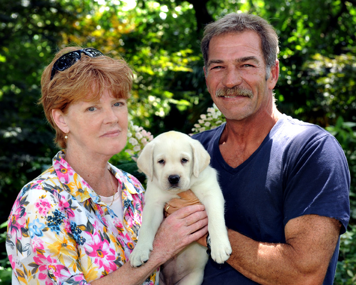 West is shown here with her husband and their yellow lab.