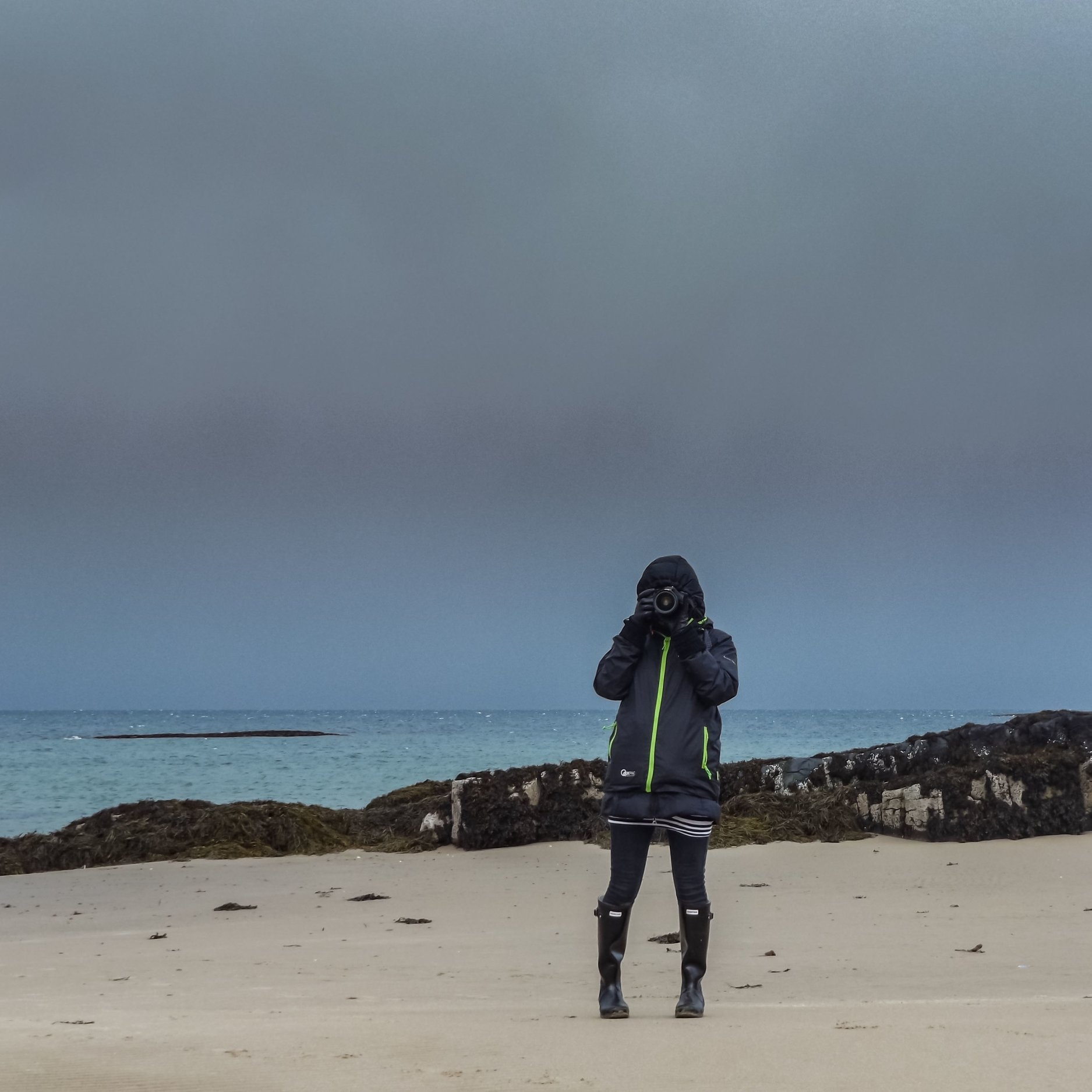 Five layers of clothing, wellies, gloves, bandy legs and an approaching storm that whipped sand in our faces as we tried to run from it. But there's always time for one more photo on Skye. Picture by Andrew Woodhouse. I particularly like the fact you can't see my face in this one.