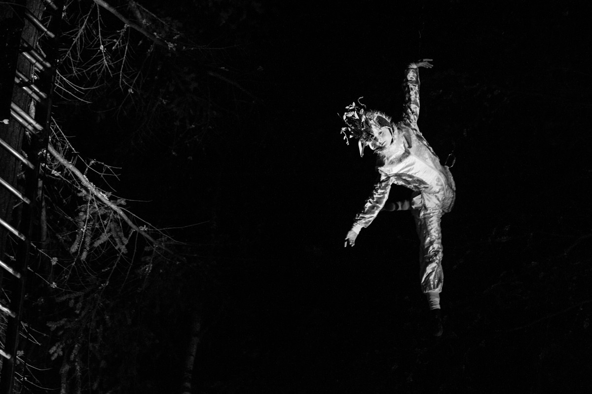 trapeze-artist-black-white-enchanted-forest-lighting-event-pitlochry.jpg