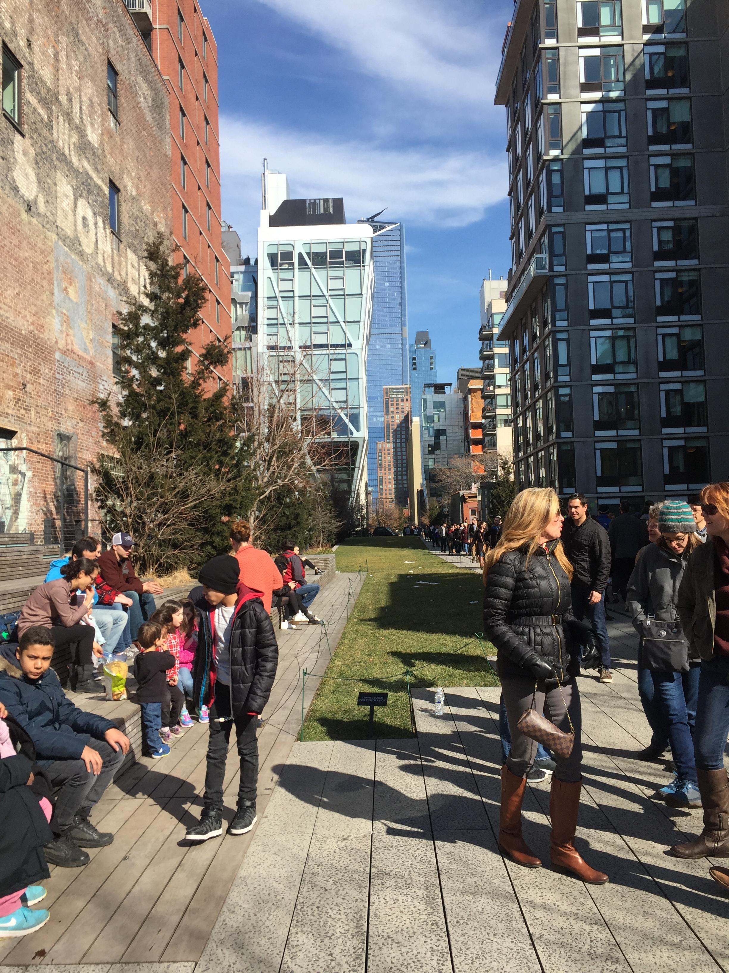 Walking between buildings in High Line Park.