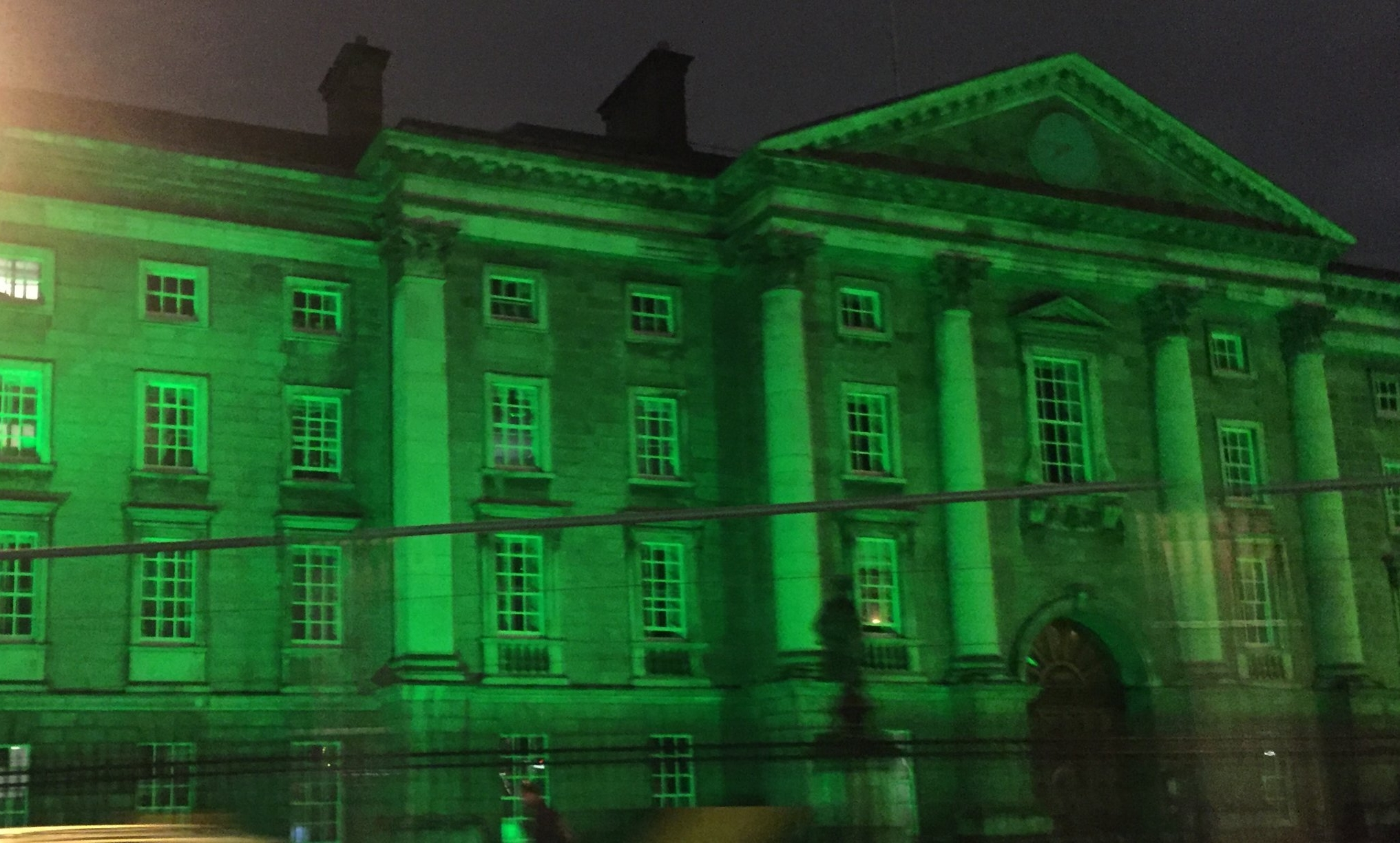 Trinity College lit up all green