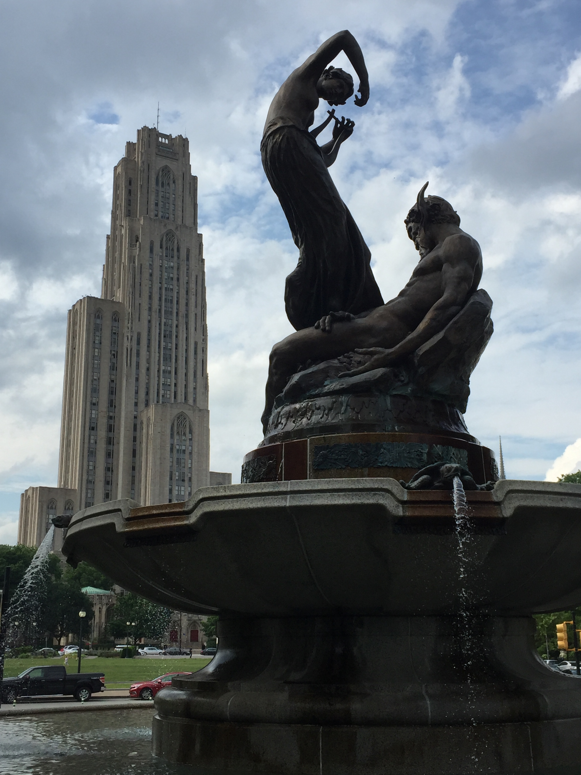 The Cathedral of Learning in the background, with the fountain of Pan and a nymph in the foreground.