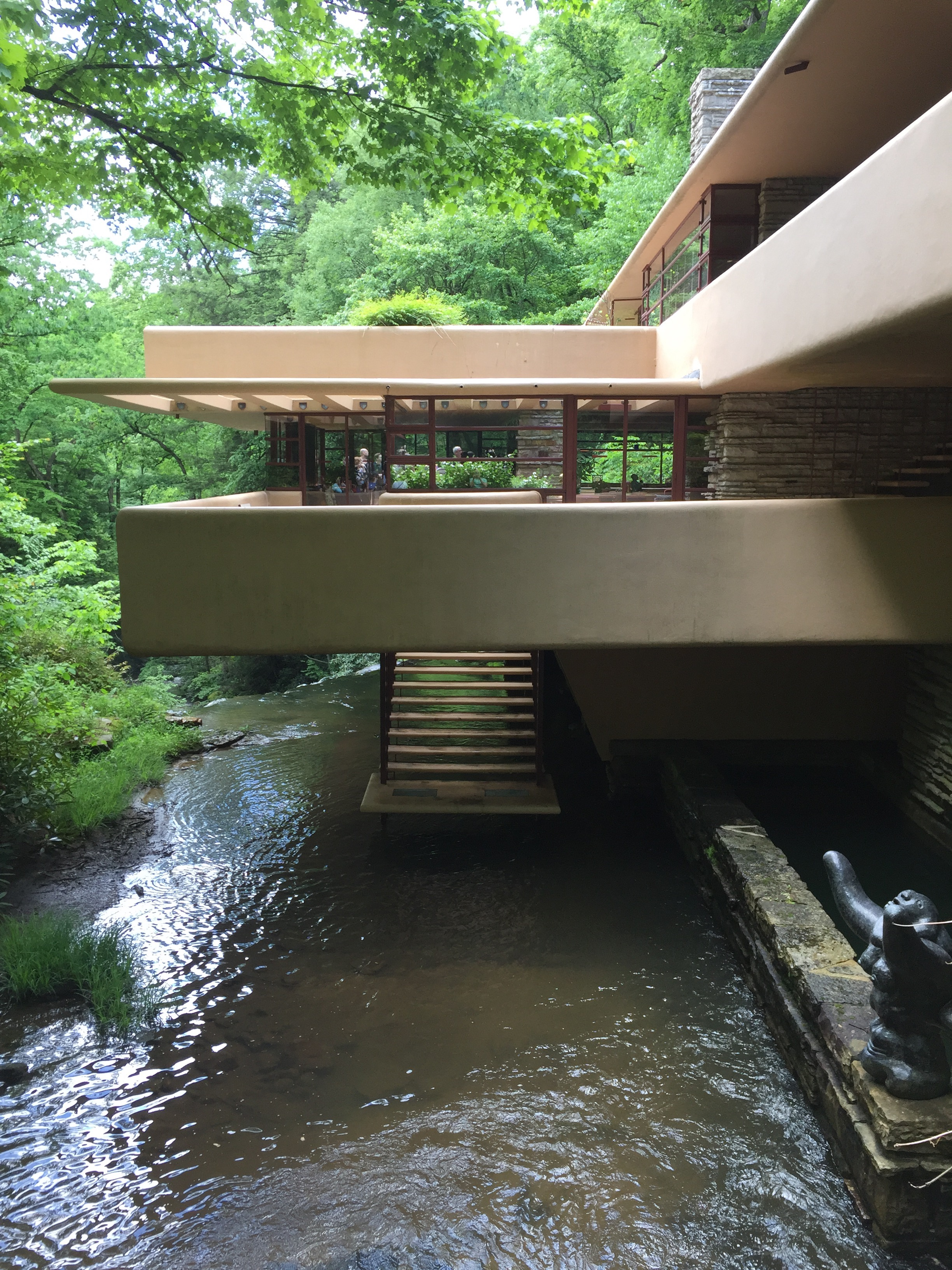 Fallingwater was built right on top of the river, which means Wright had to use a cantilever system to anchor the portions of the house that extend over the river. He also used the natural coolness of the river as a natural air conditioner for the house, and as a ready-made swimming hole on hot summer days.