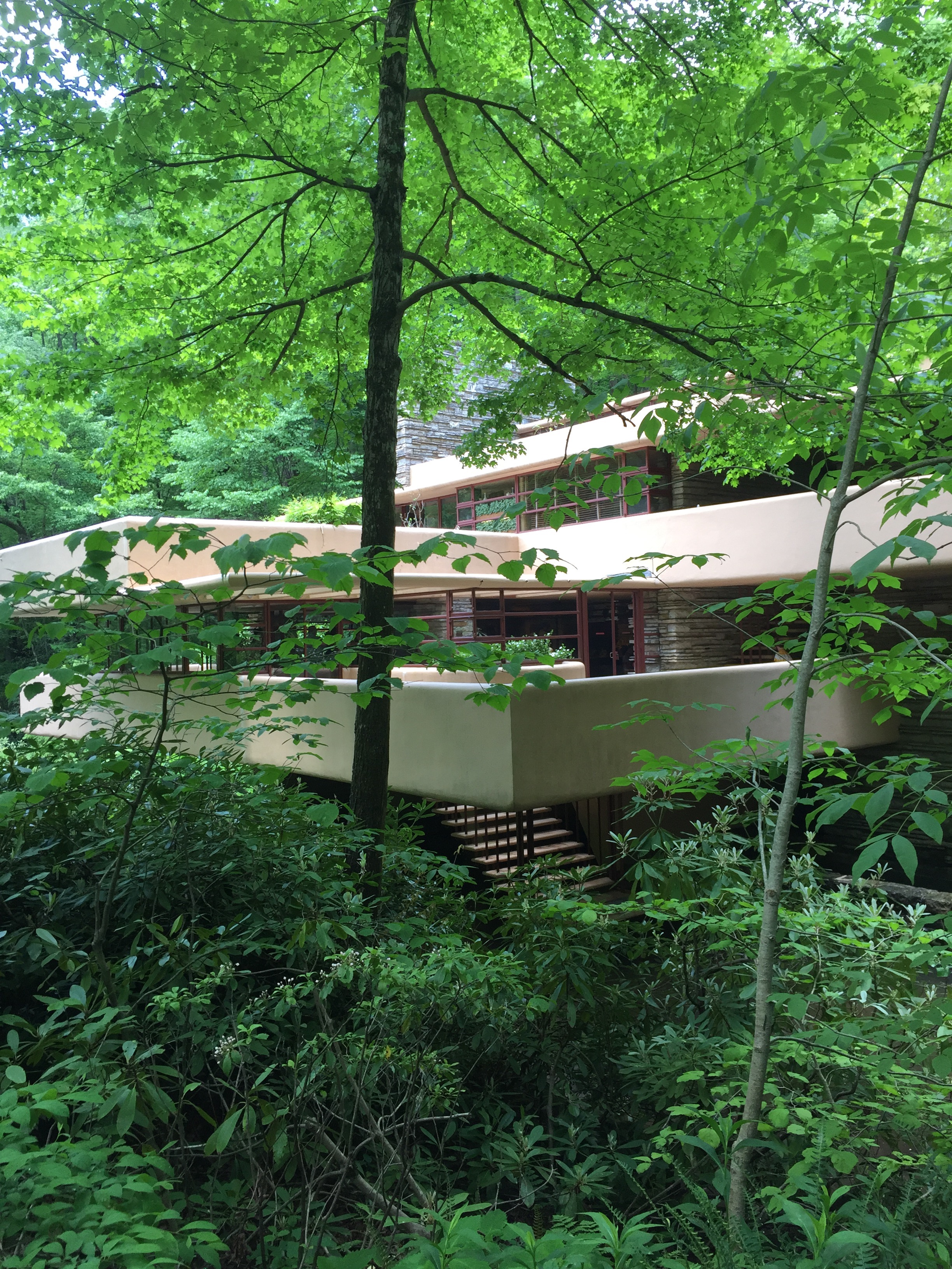 Each bedroom and the living room has its own private terrace, adding to the blending of nature and building. Wright used natural paint colors for the cement and the steel to keep with oneness with nature.