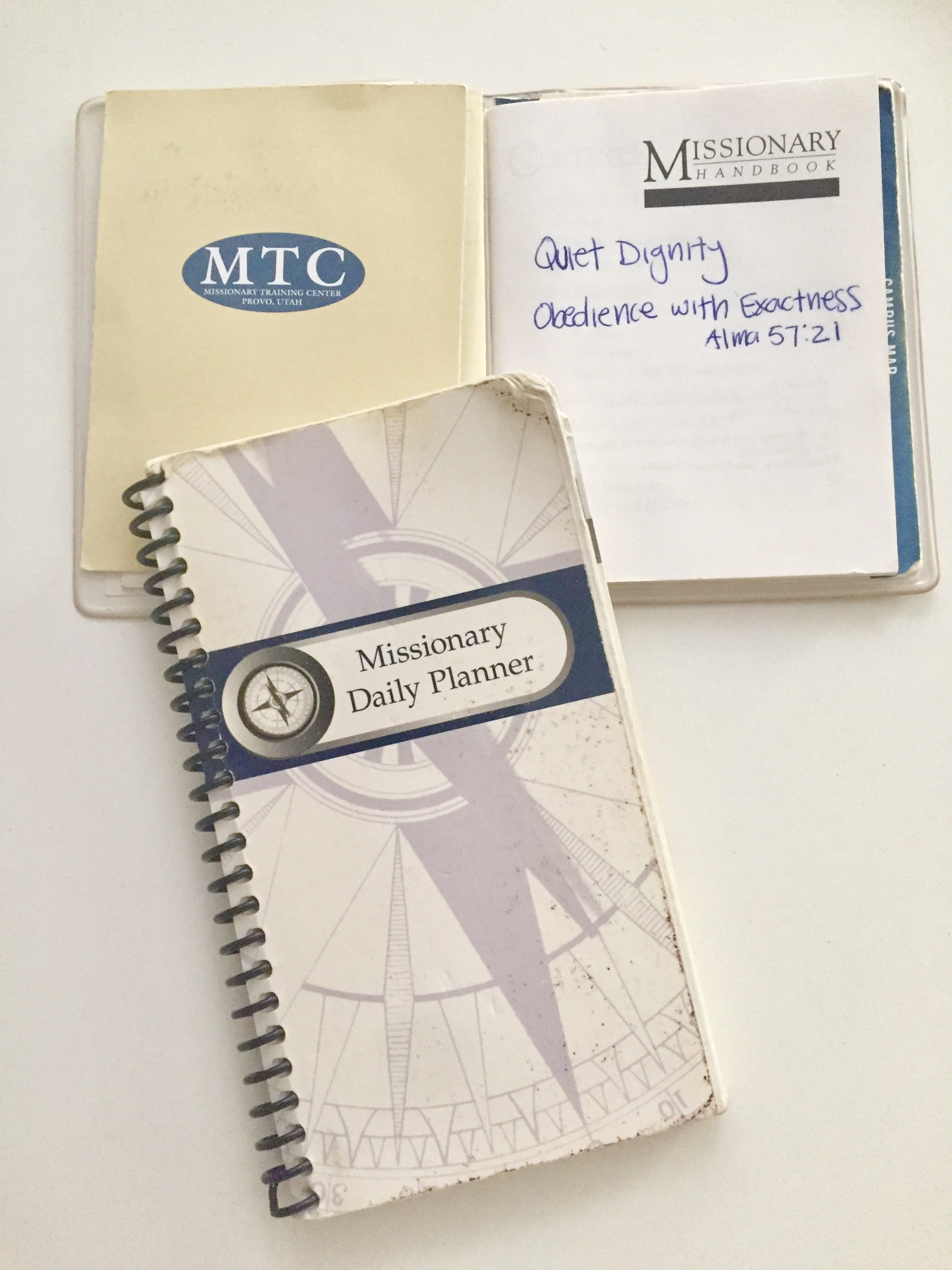 One of our daily planner books that we used to coordinate every minute of our day. Also the white handbook which contained all the rules for missionaries across the Church.