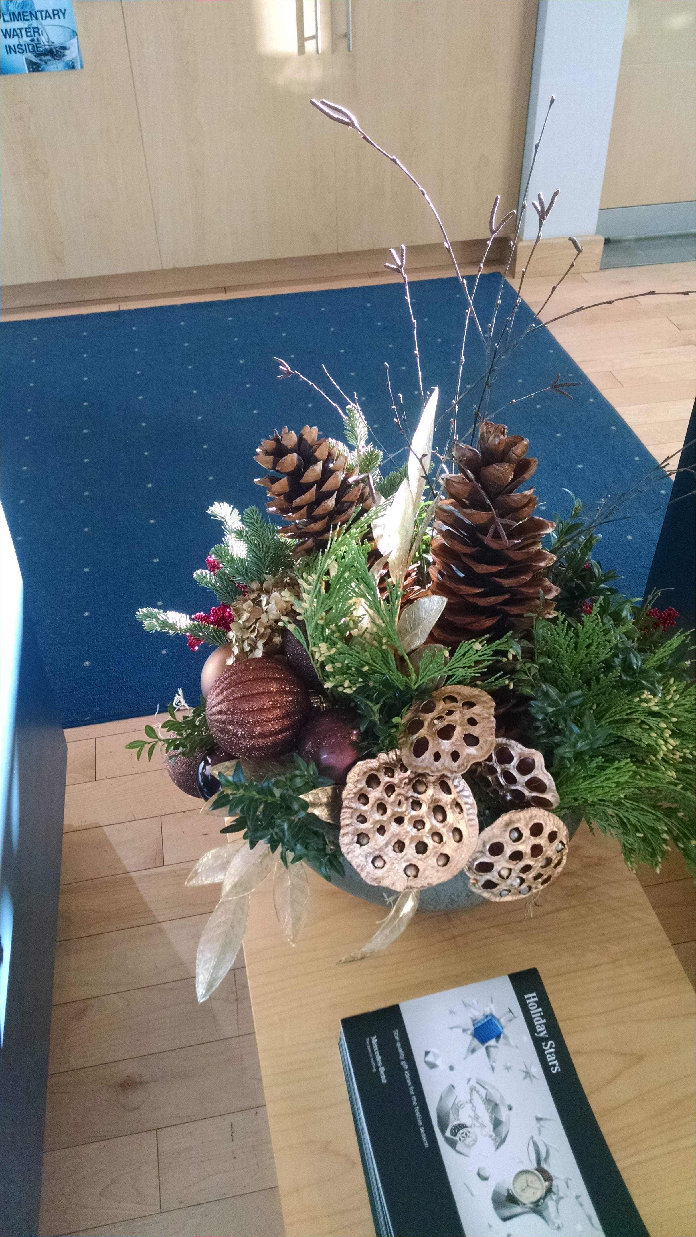 C- Centerpiece with golden honey combs and pine.jpg