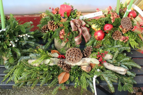 C- Centerpiece with honey comb, pinecones, and candle.jpg