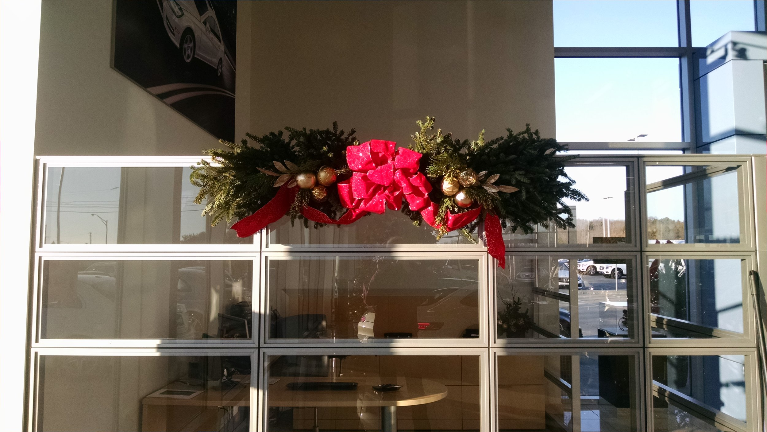 M-Mantle piece with bow in car dealership.jpg