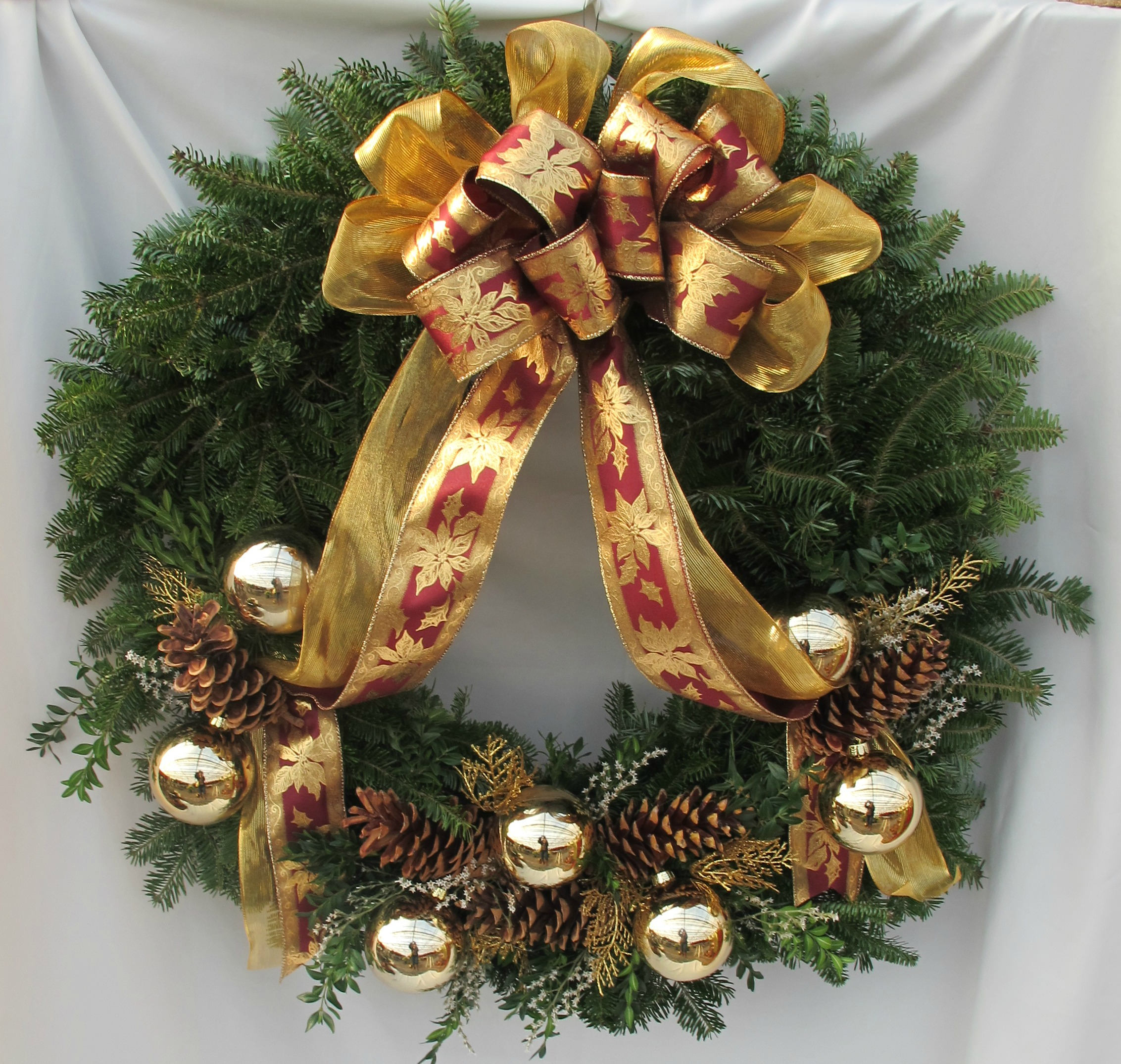W- Gold riibbon with gold balls and pine cones.jpg