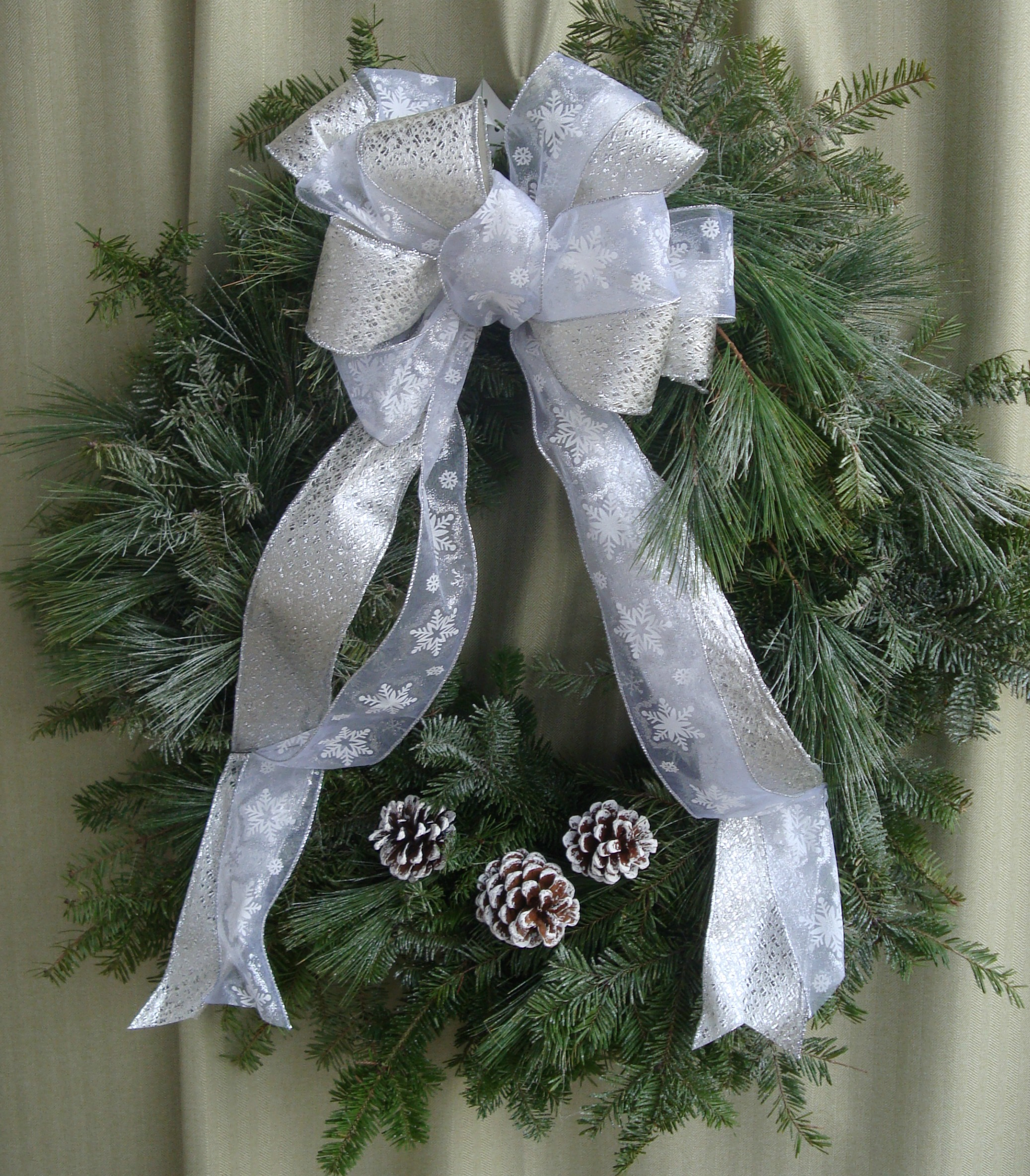 W- Silver ribbon and white tipped pinecones.jpg