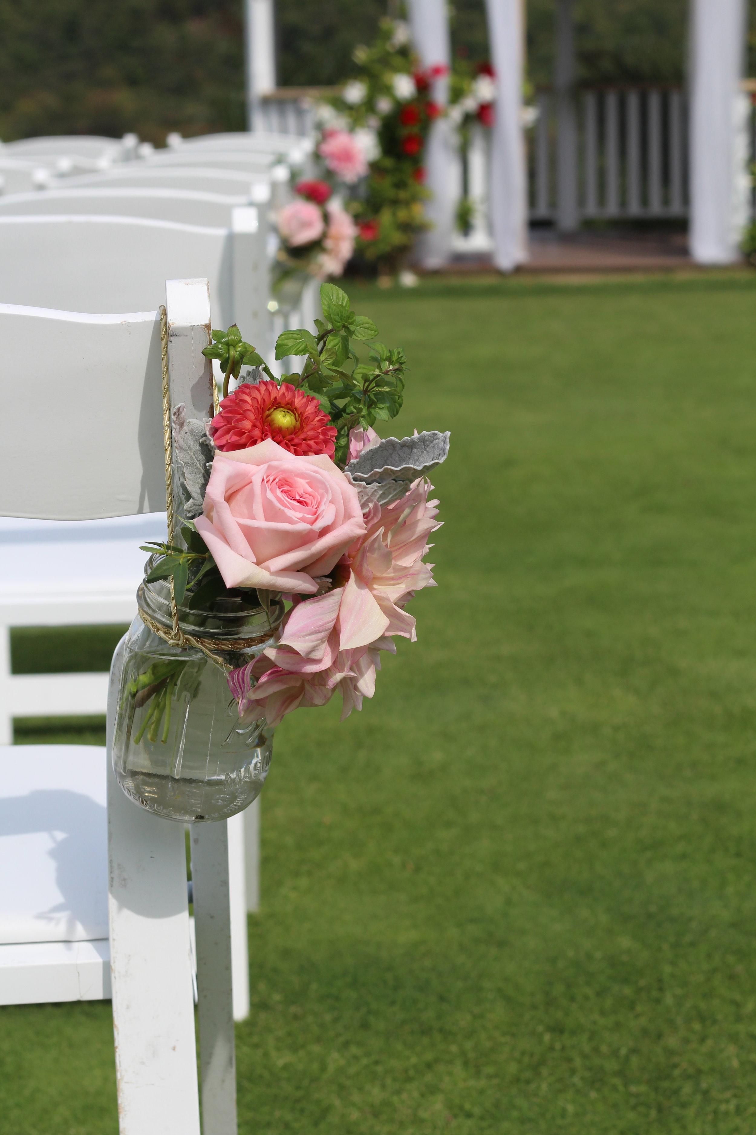 A- Mason jar of pew flowers.JPG