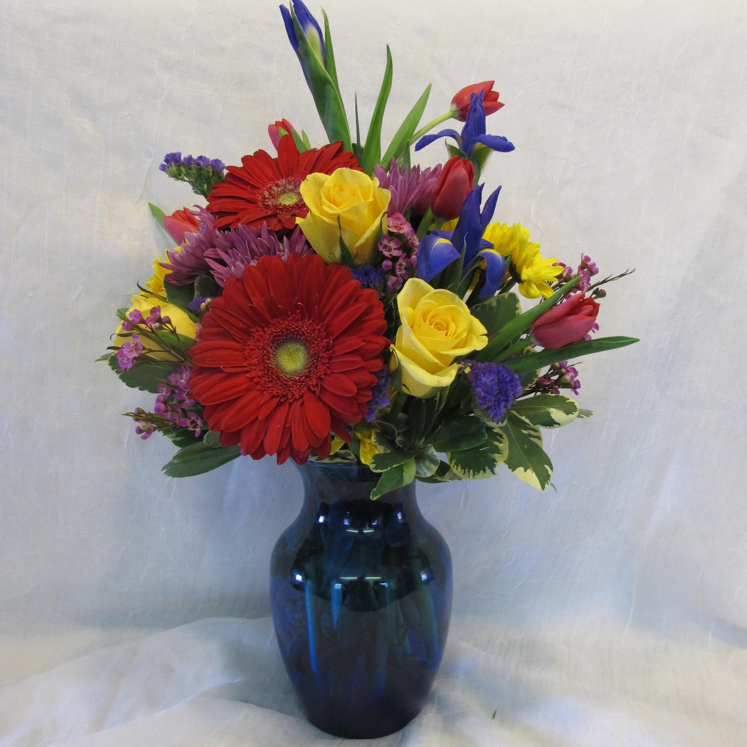 Blue vase with bold flowers.JPG