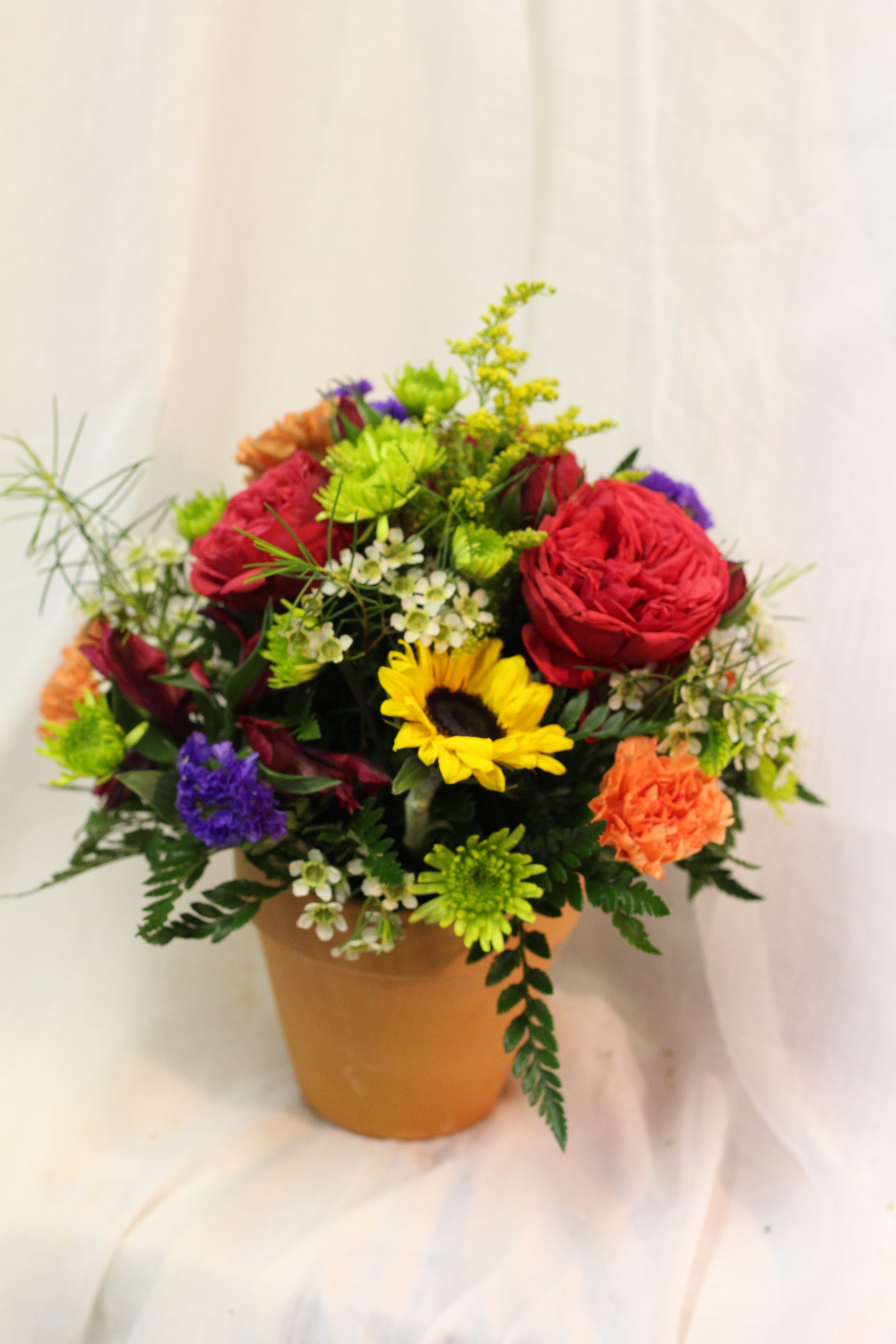 Clay pot of cut flowers.JPG