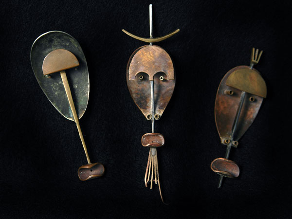 THREE MASK BROOCHES