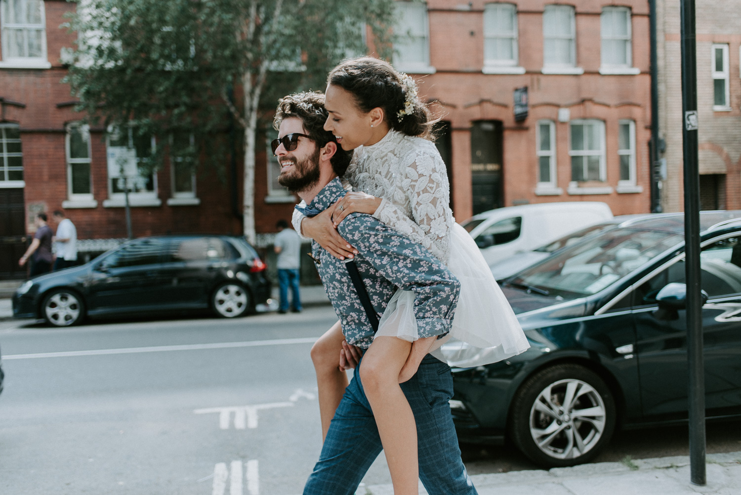 Bride and Groom portrait of a piggy back ride through East London. These two had just had an intimate wedding celebration in Shoreditch.