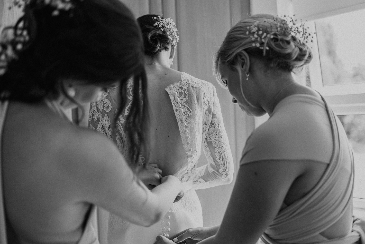 Black and white bridal prep image of Kathryn. She had planned an intimate wedding in rural Warwickshire.