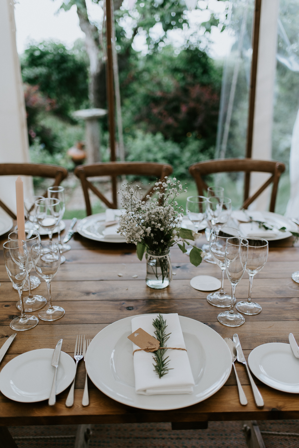 Rustic chic table setting with a twig of thyme, wooden table and picked field flowers. These to had an intimate wedding celebration in rural Warwickshire.