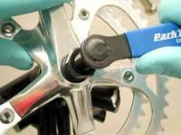 Remove the crank arm by turning the driver clockwise.
