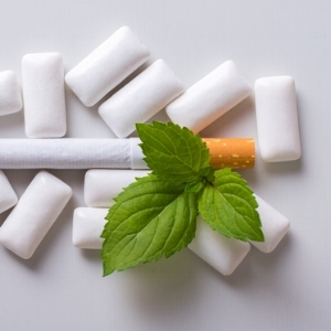 stock-photo-cigarettes-and-chewing-gum-with-mint-451663414.jpg