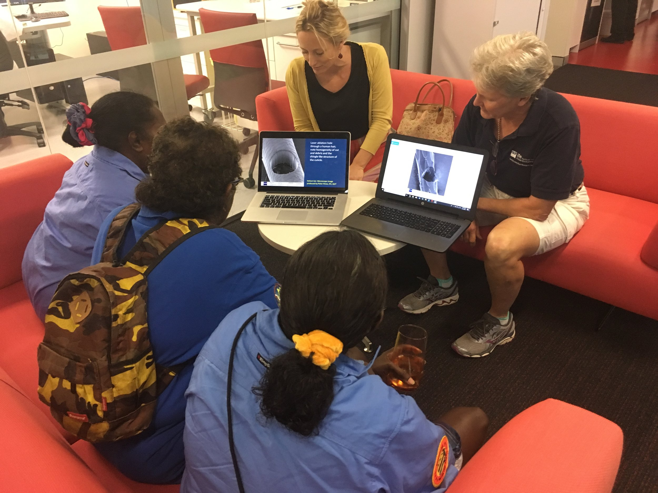 Photo: Left, Charlotte Allen (back right) explaining how scanning helium ion microscopy works on human and animal hair on Groote, to Jocelyn Yantarrgna, Catherine Mamarika, Cassandra Mamarika & Gwendolyn David.