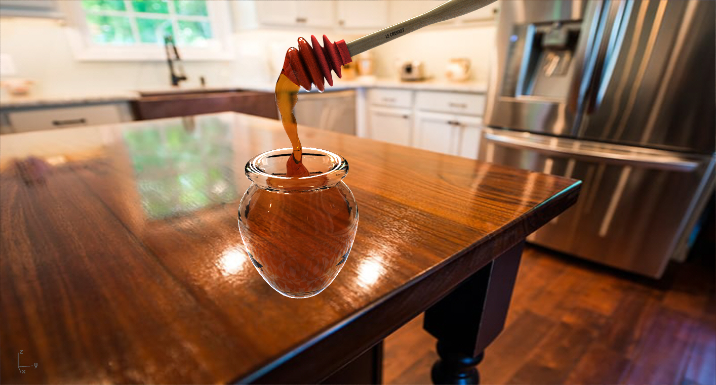 Le Creuset Honey dipper and glass jar of honey