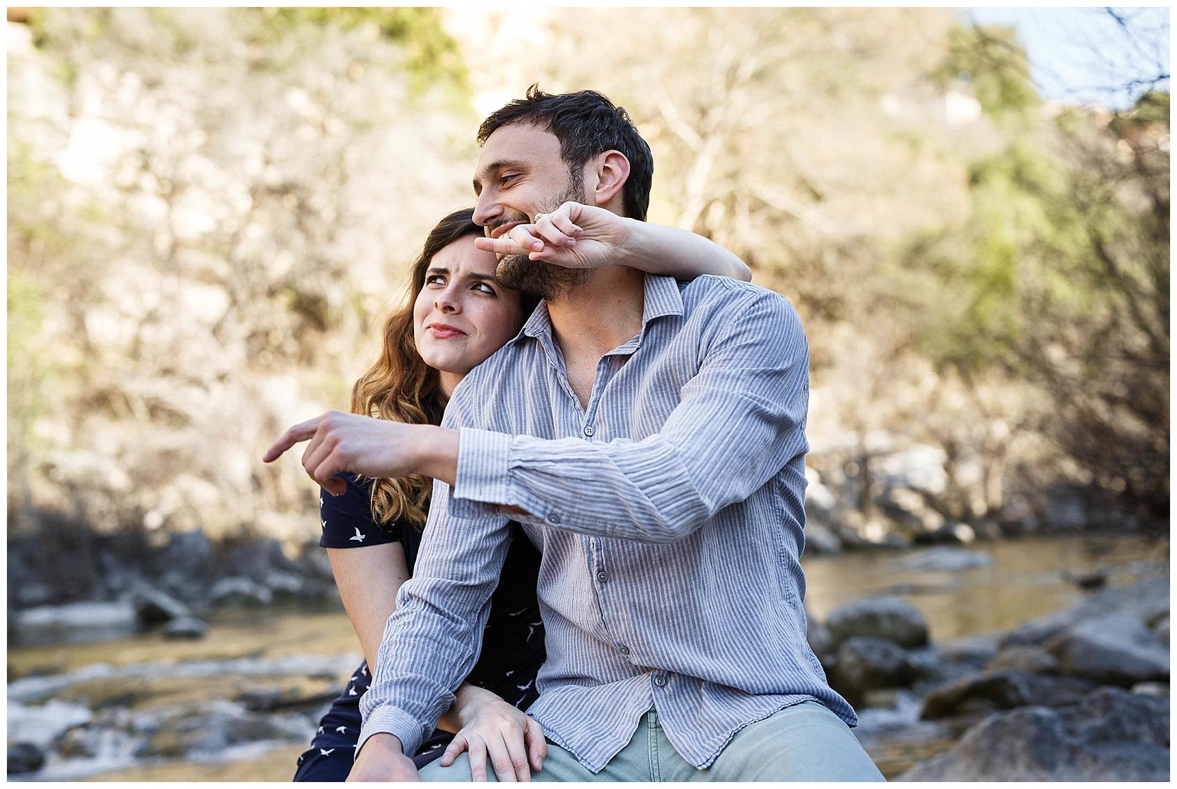 engaged couple sitting in Austin's greenbelt