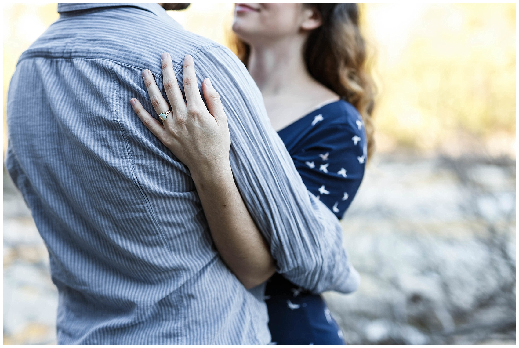 engaged couple hugging in Austin's greenbelt