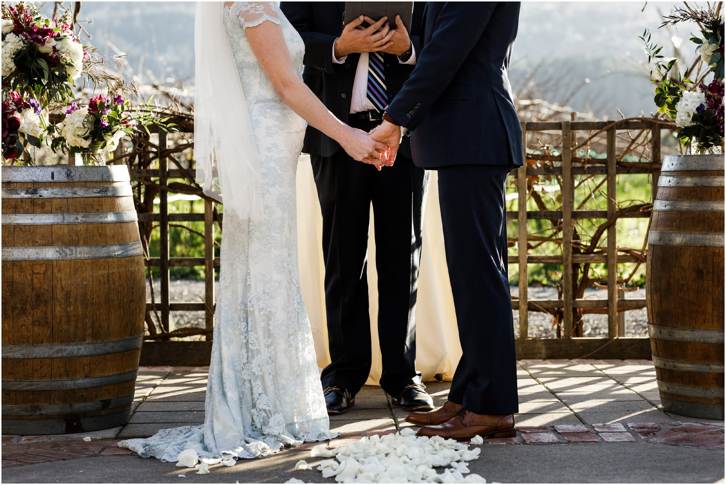 bride and groom holding hands during ceremony at the Harvest Inn