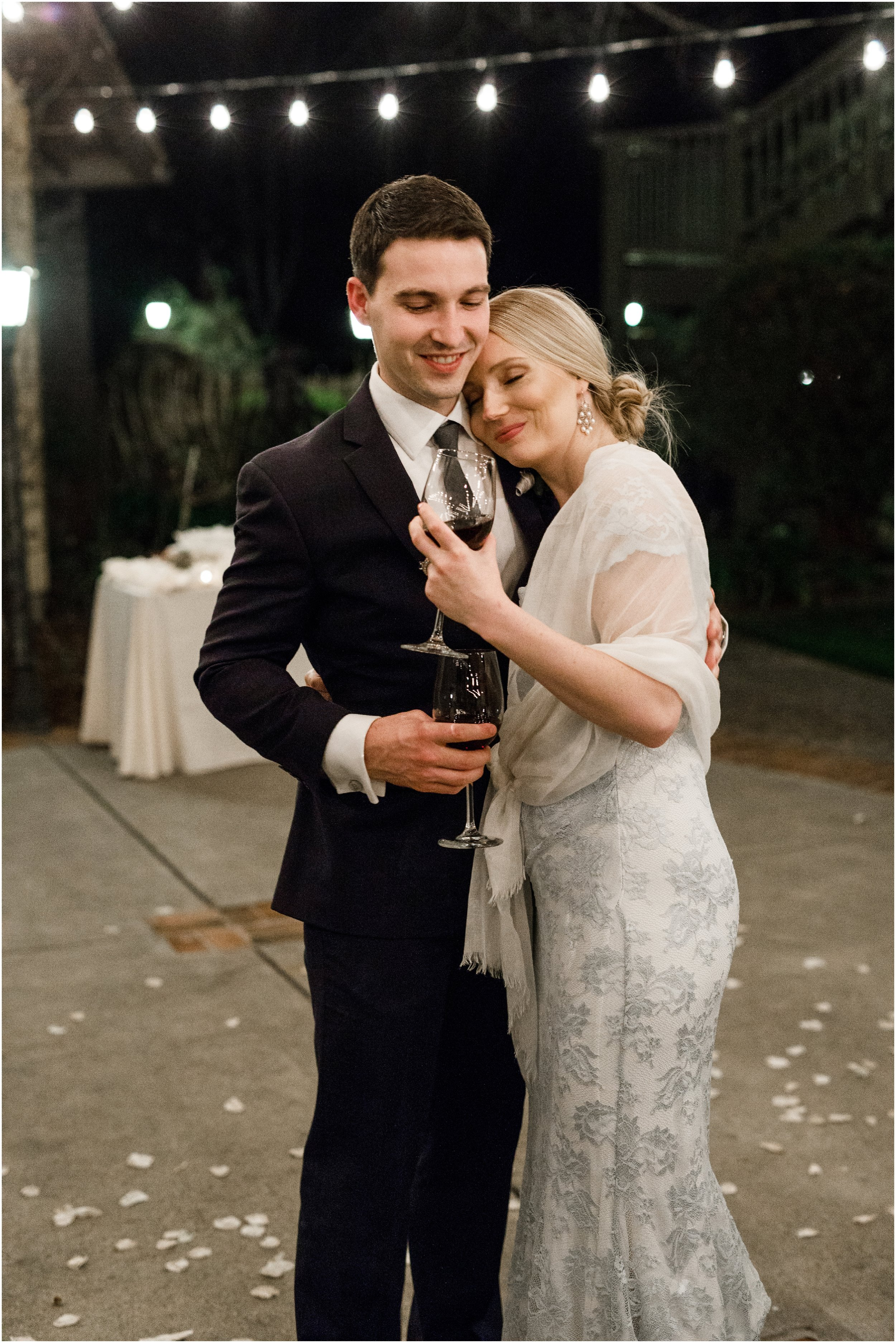 bride and groom embracing during reception