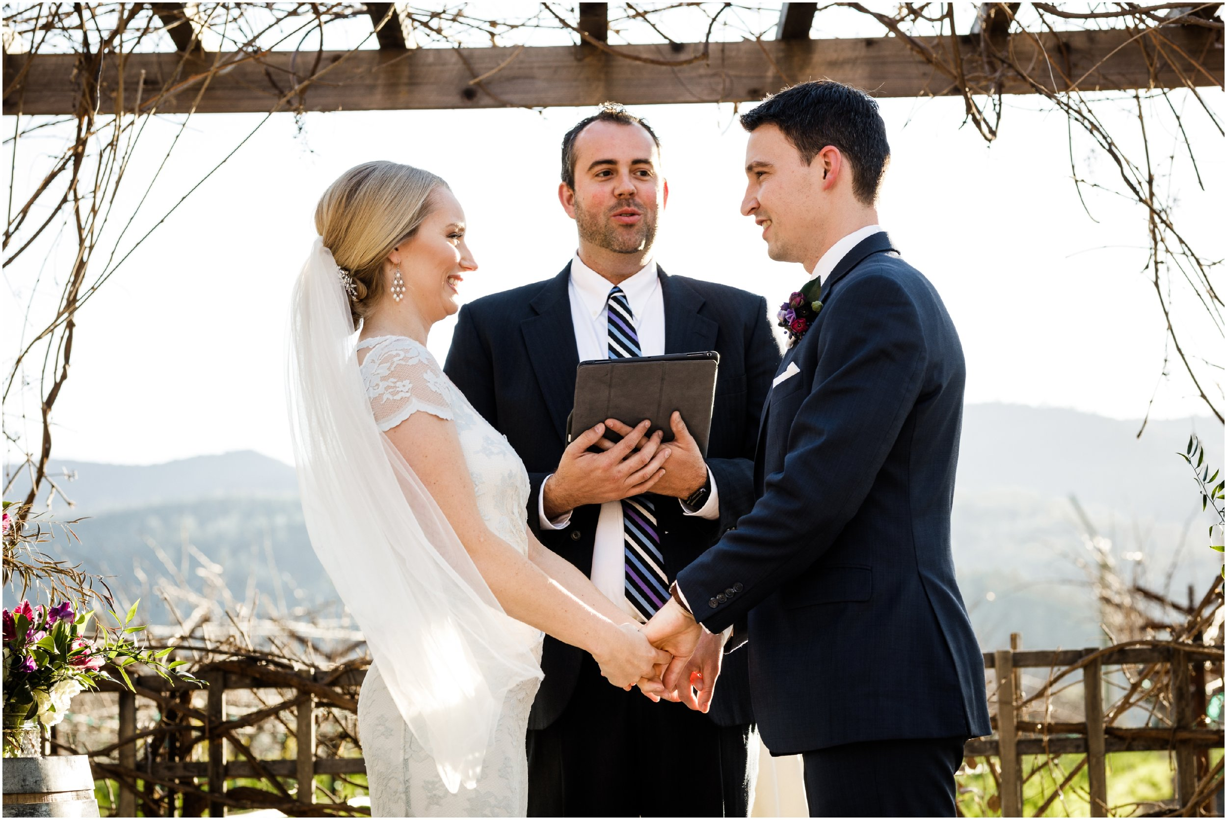 bride and groom during outdoor ceremony at the Harvest Inn