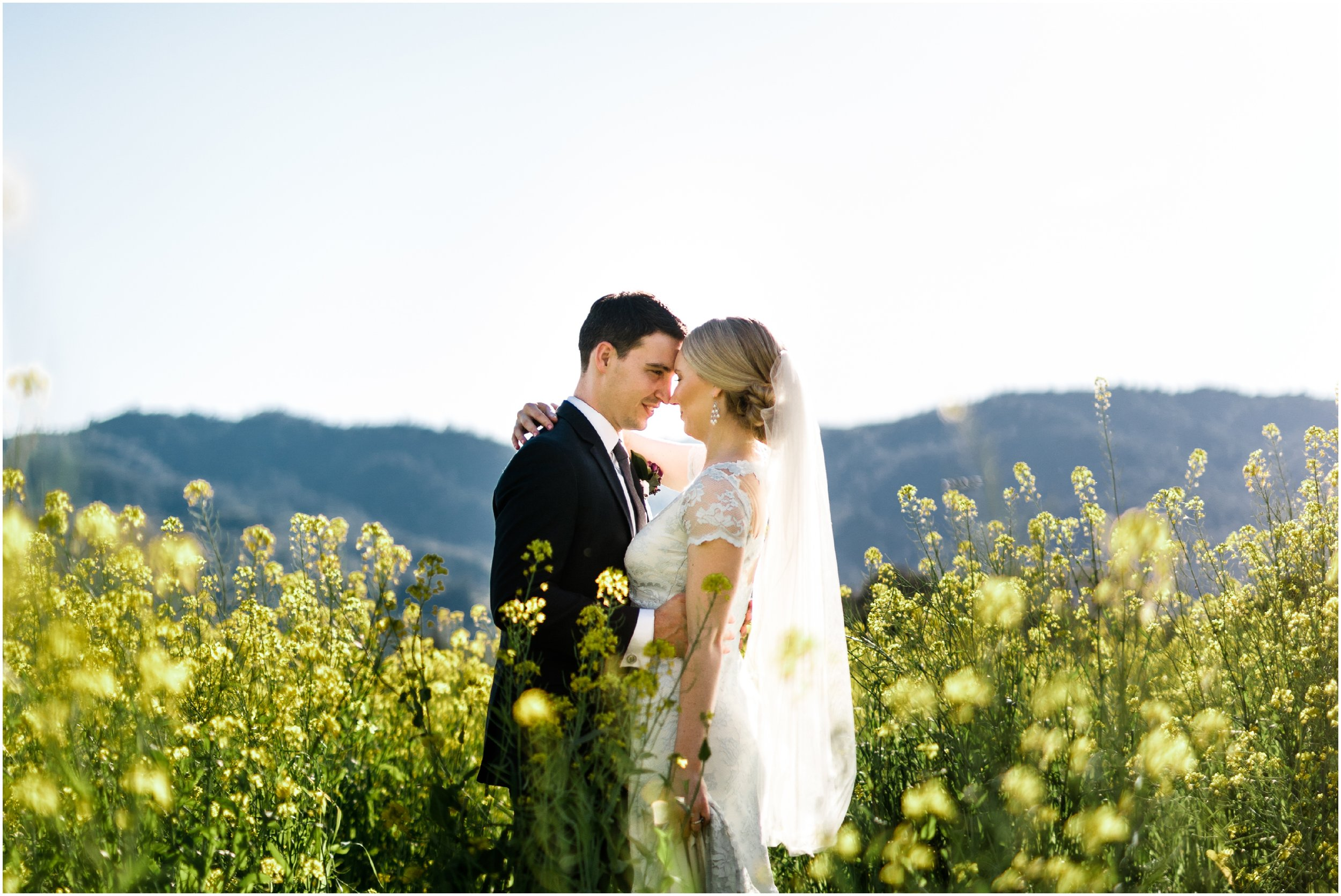 bride and groom posing in a field of flowers in Napa Valley
