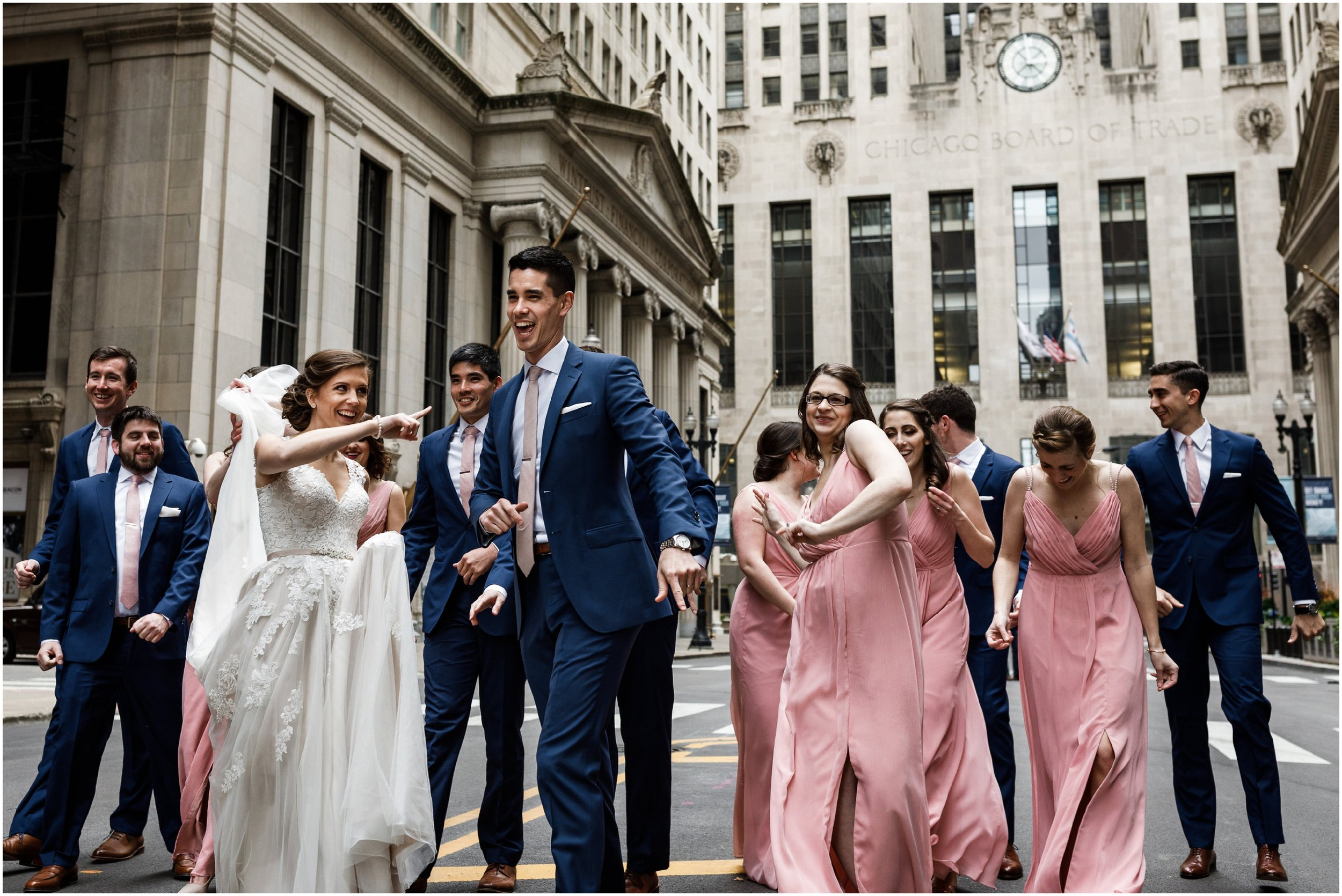 wedding party dancing in front of the Chicago Board of Trade