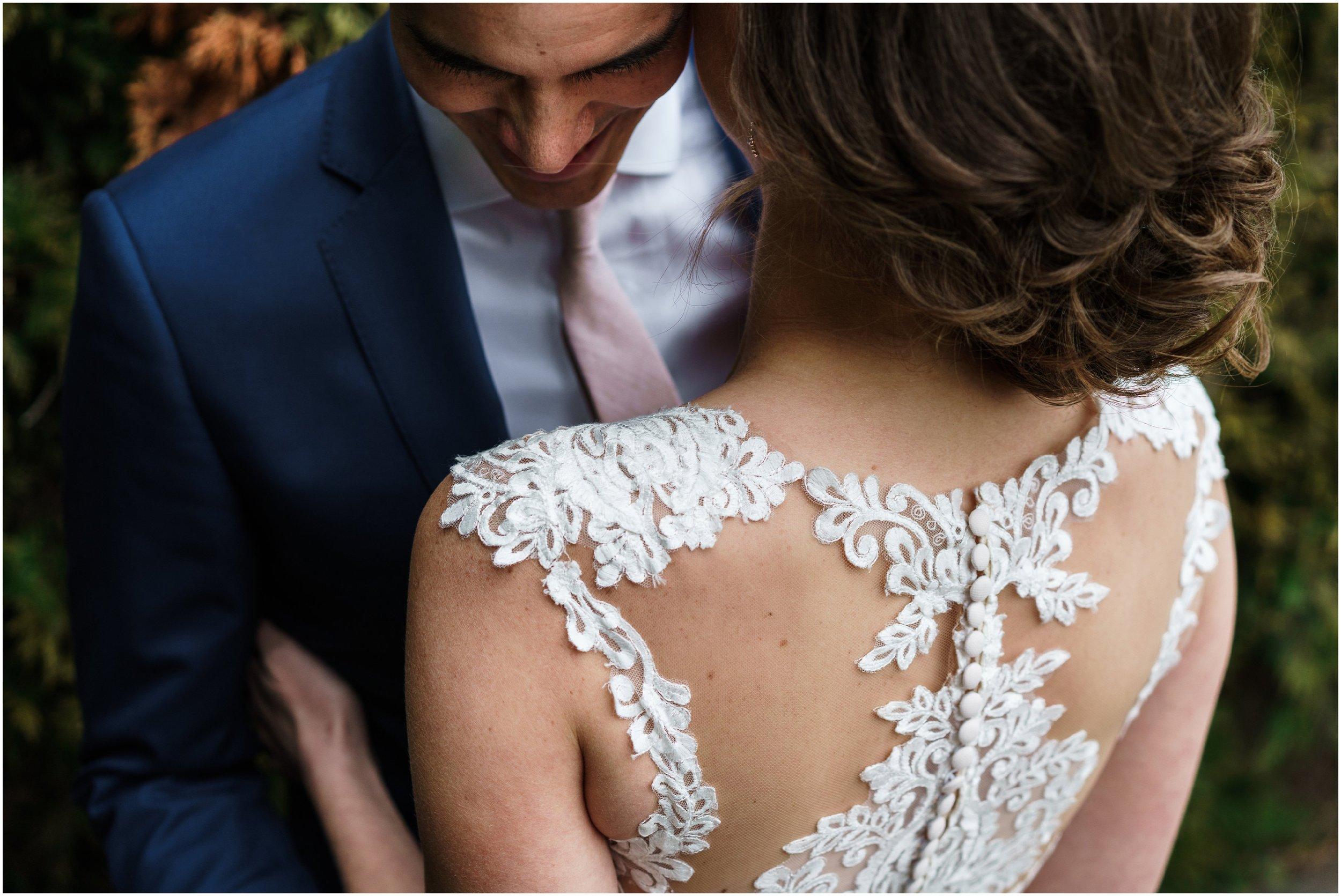 bride and groom embracing in Millennium park's Lurie garden