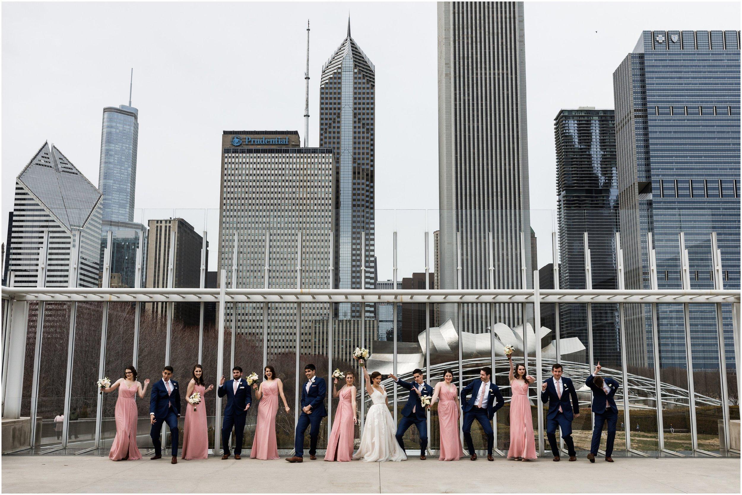 wedding party dancing in front of Millennium park