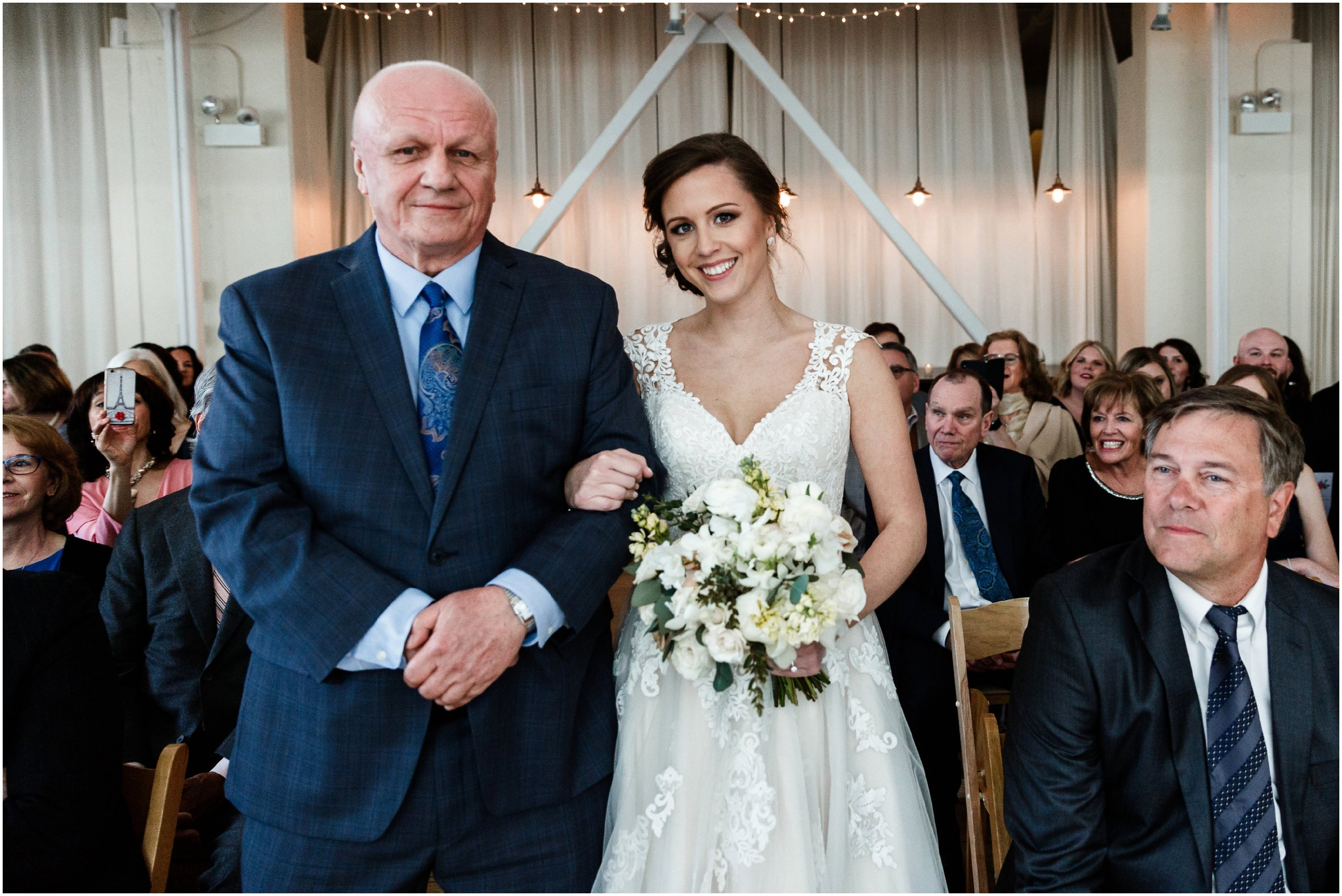 bride and her father walking down the aisle during procession