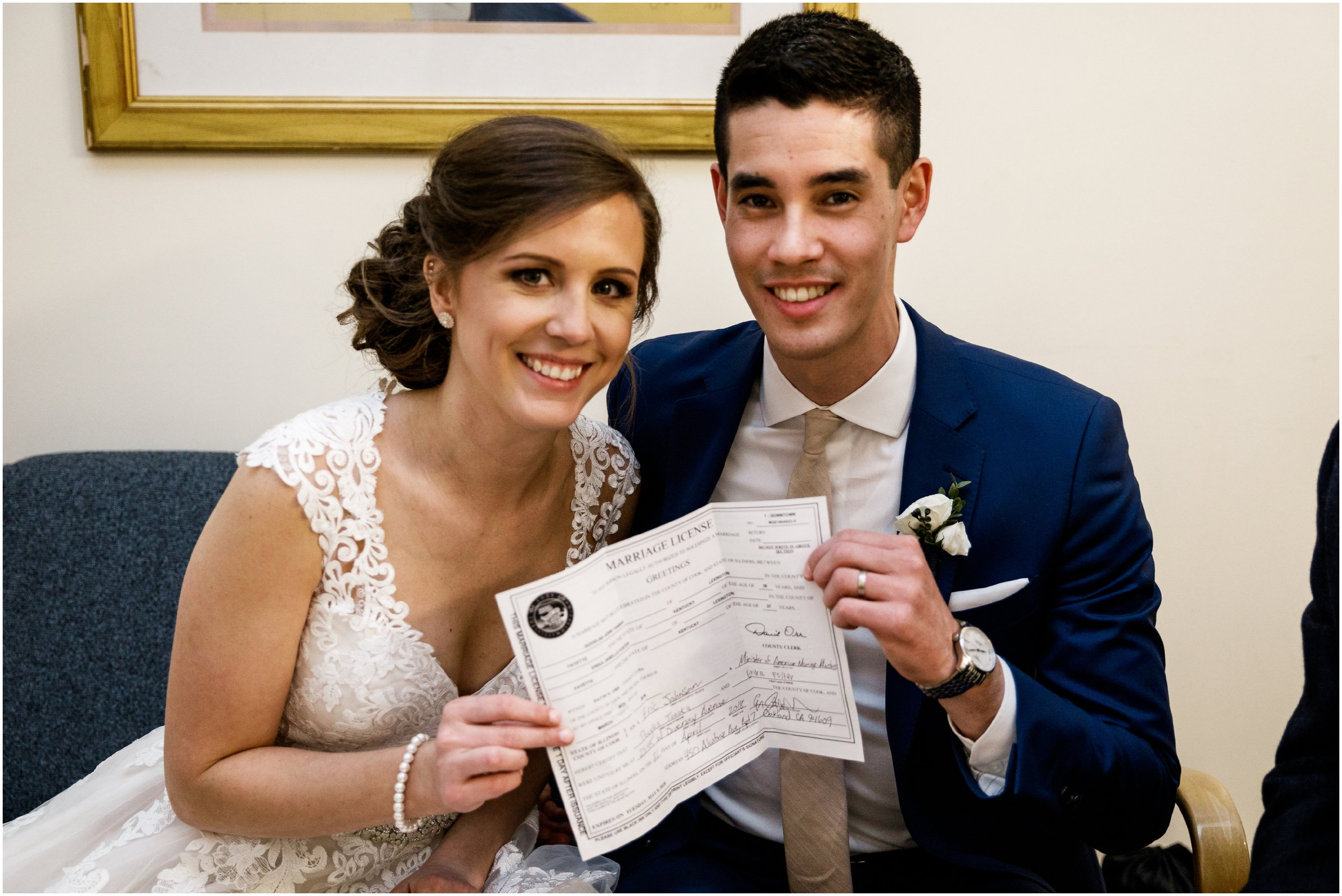 bride and groom holding their marriage license