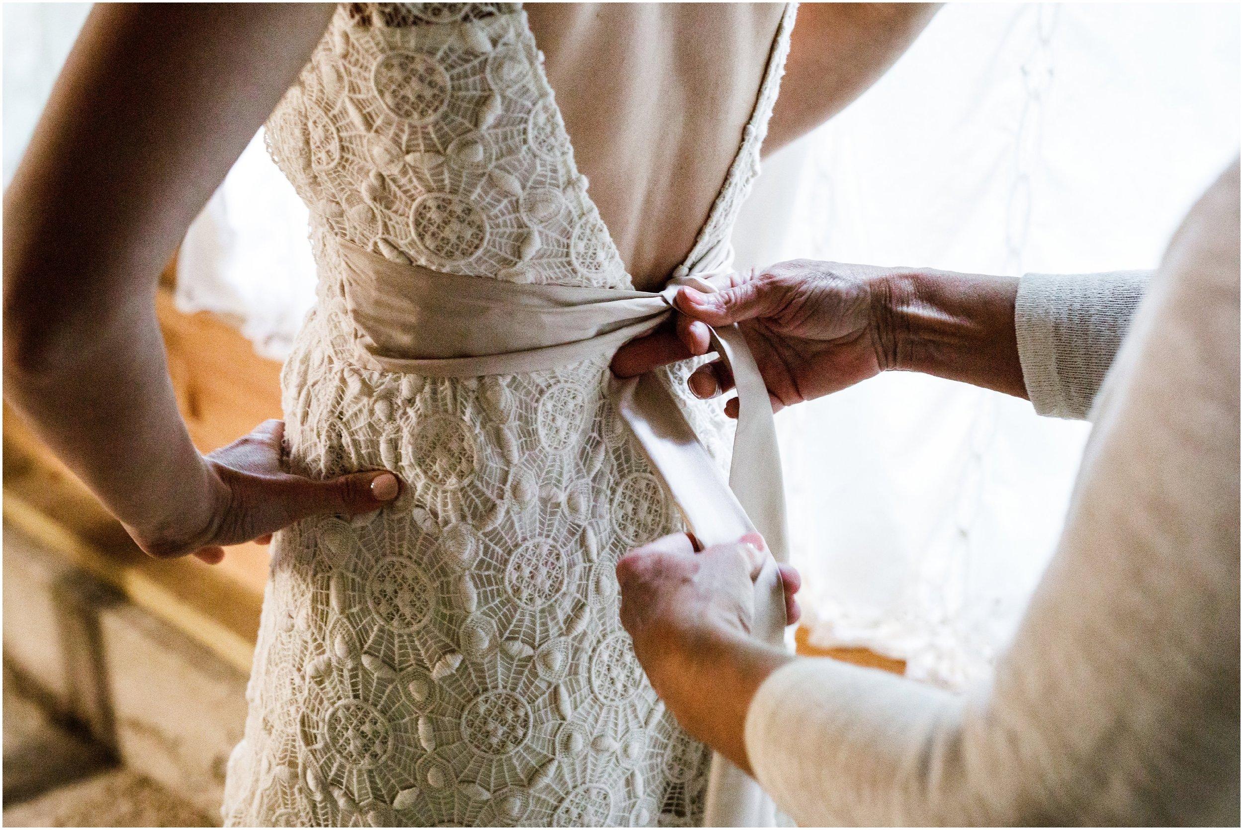 wedding dress sash being tied