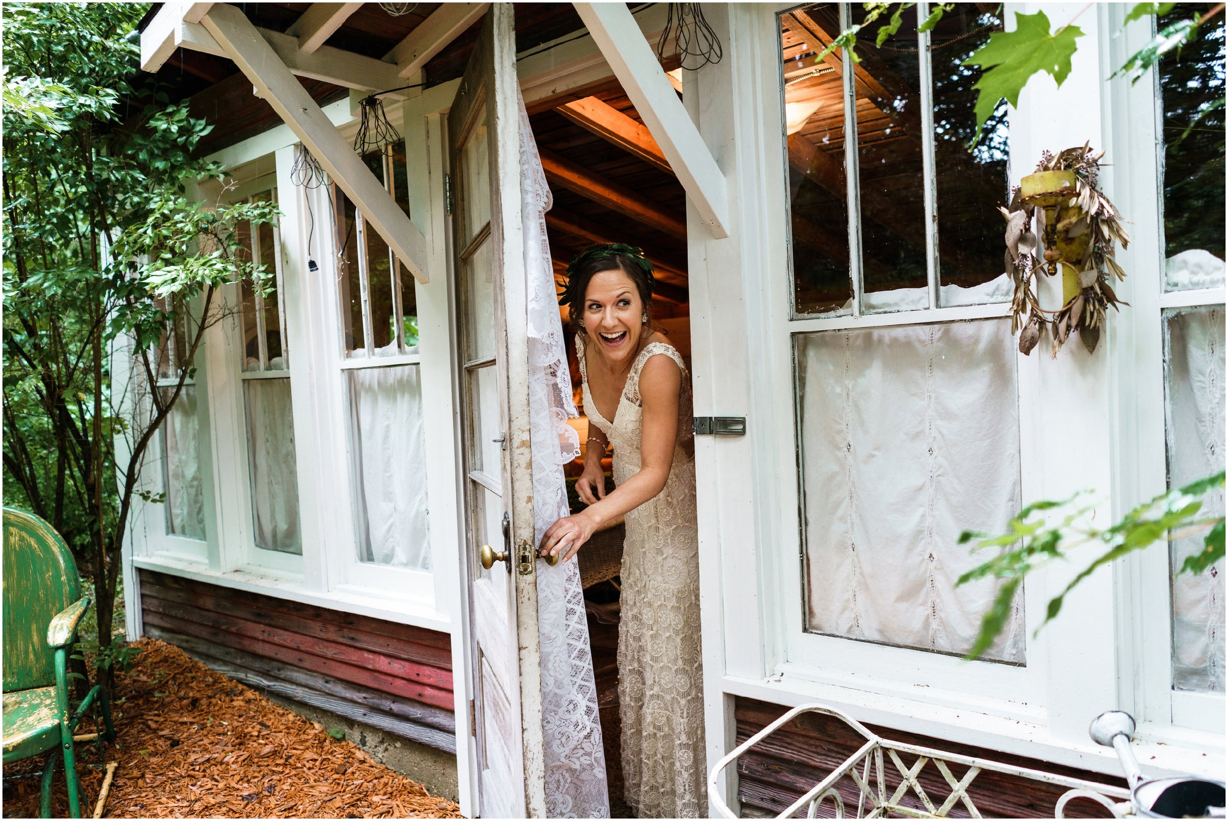bride peeking out of bridal studio