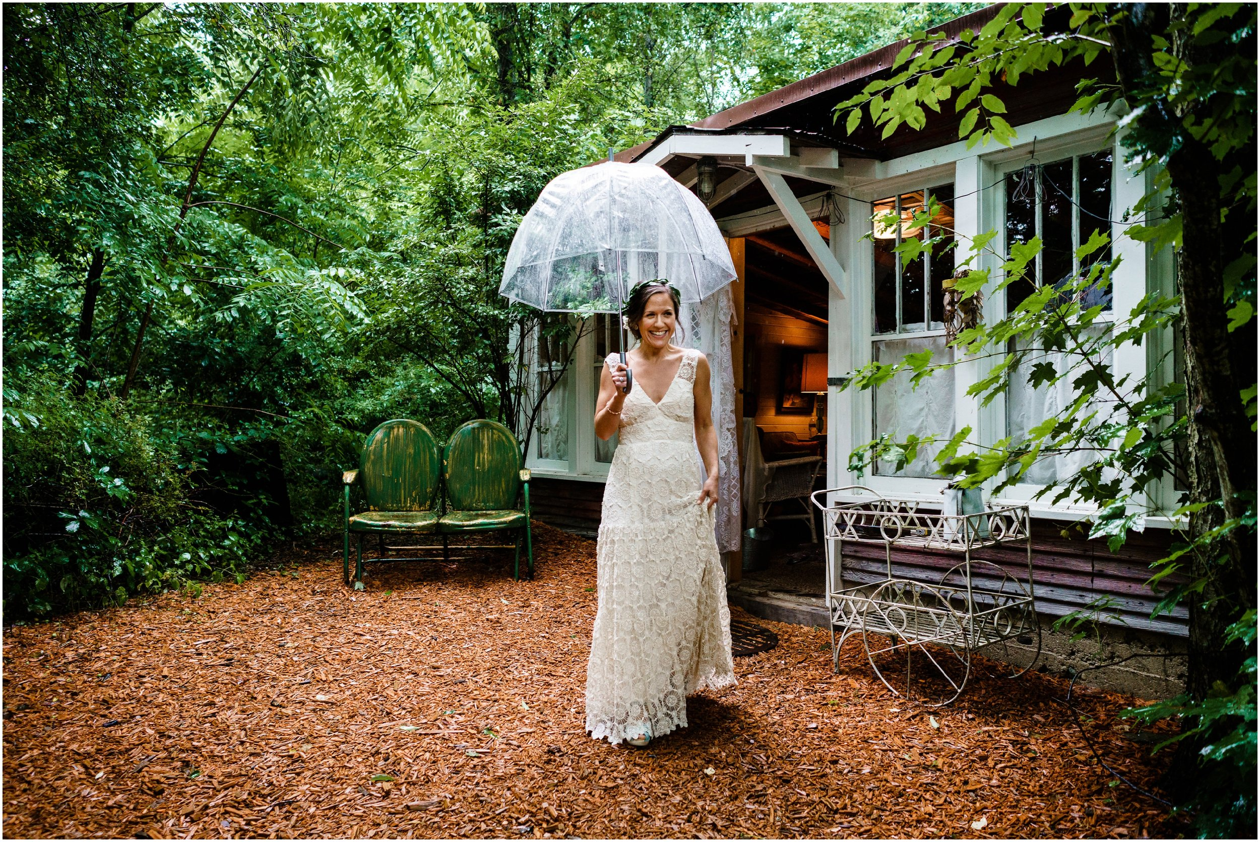 bride holding umbrella during first look