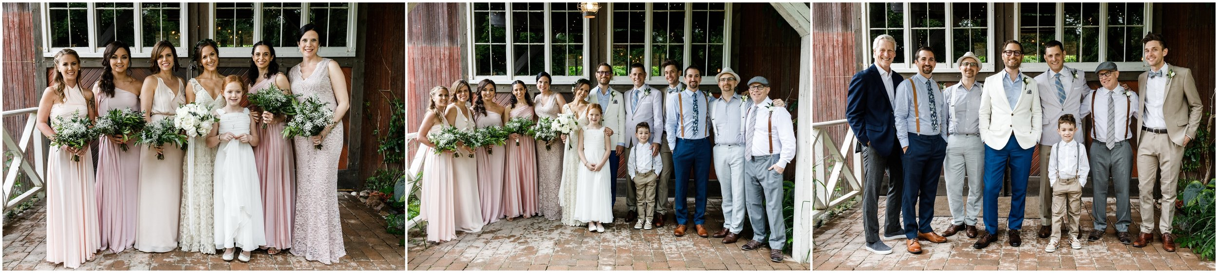 bridal party posing in front of barn