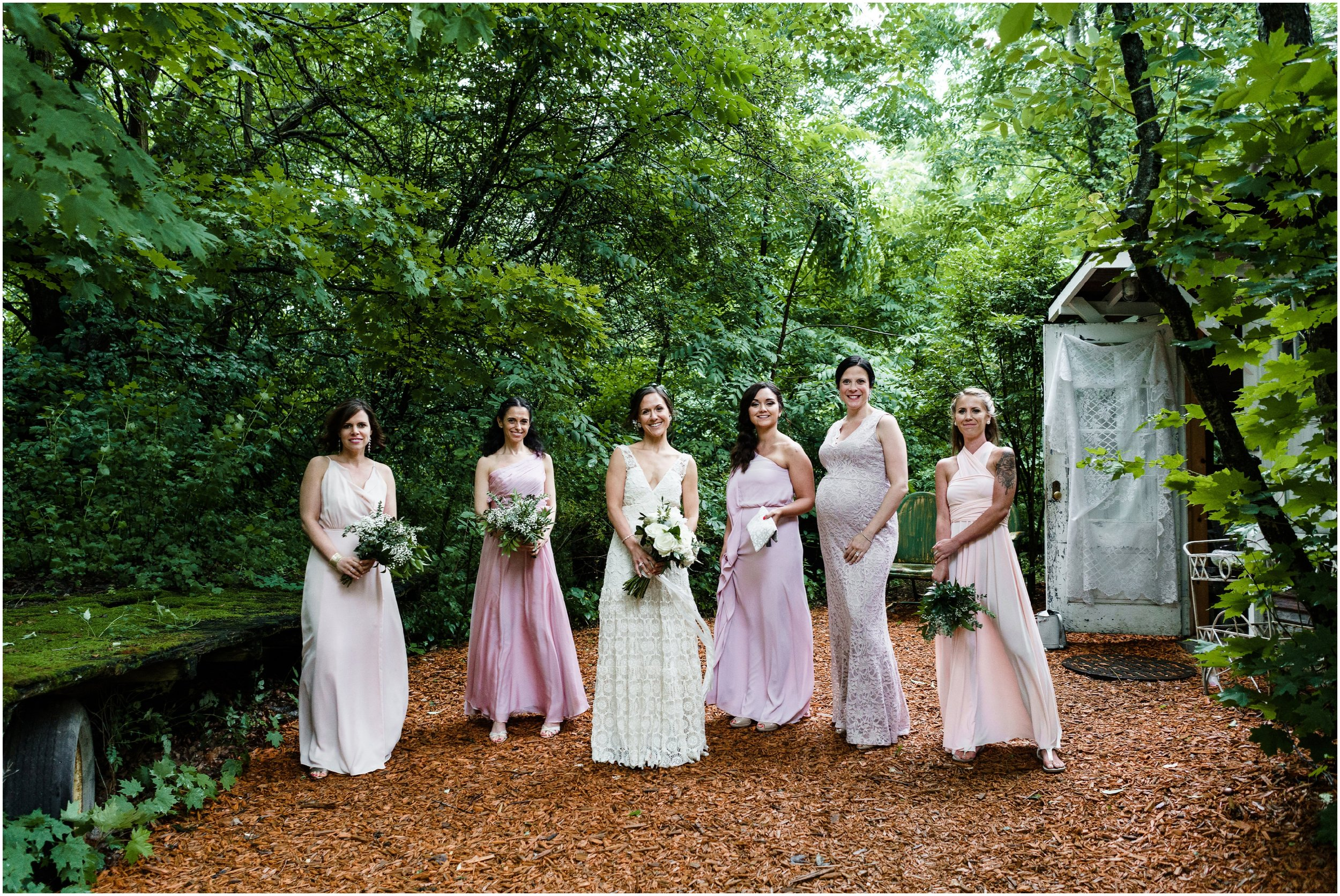 bridal party posing in front of bridal studio