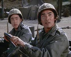 "G.I. Joe writer    Larry Hama    (left) in ""The Korean Surgeon"" episode of M.A.S.H. (1976)."