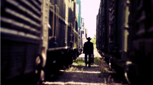 Gord Walking Away In Silhouette Between Rail Cars.jpg