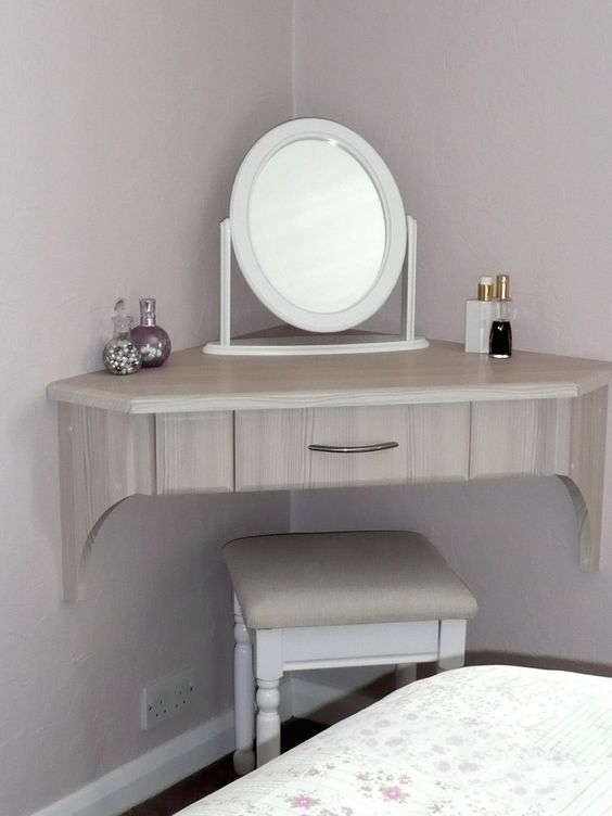 This triangular dressing table was designed to fit into a corner of the room that would've otherwise gone unused. Via Jarrods Staircases.