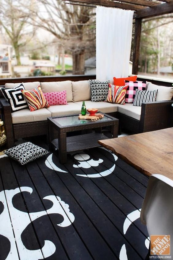 OUTDOOR DECORATING WITH COLOR: A BEAUTIFUL COVERED PATIO WITH AN OUTDOOR SECTIONAL, COFFEE TABLE AND PAINTED FLOOR BY KRISTIN JACKSON ( JACKSON | THE HUNTED INTERIOR)