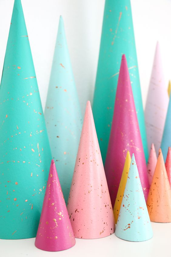 Kara at the Kailo Chic Life blog has some of the most inspiring DIY tutorials ever, including these gorgeous  splatter paint Christmas tree s.