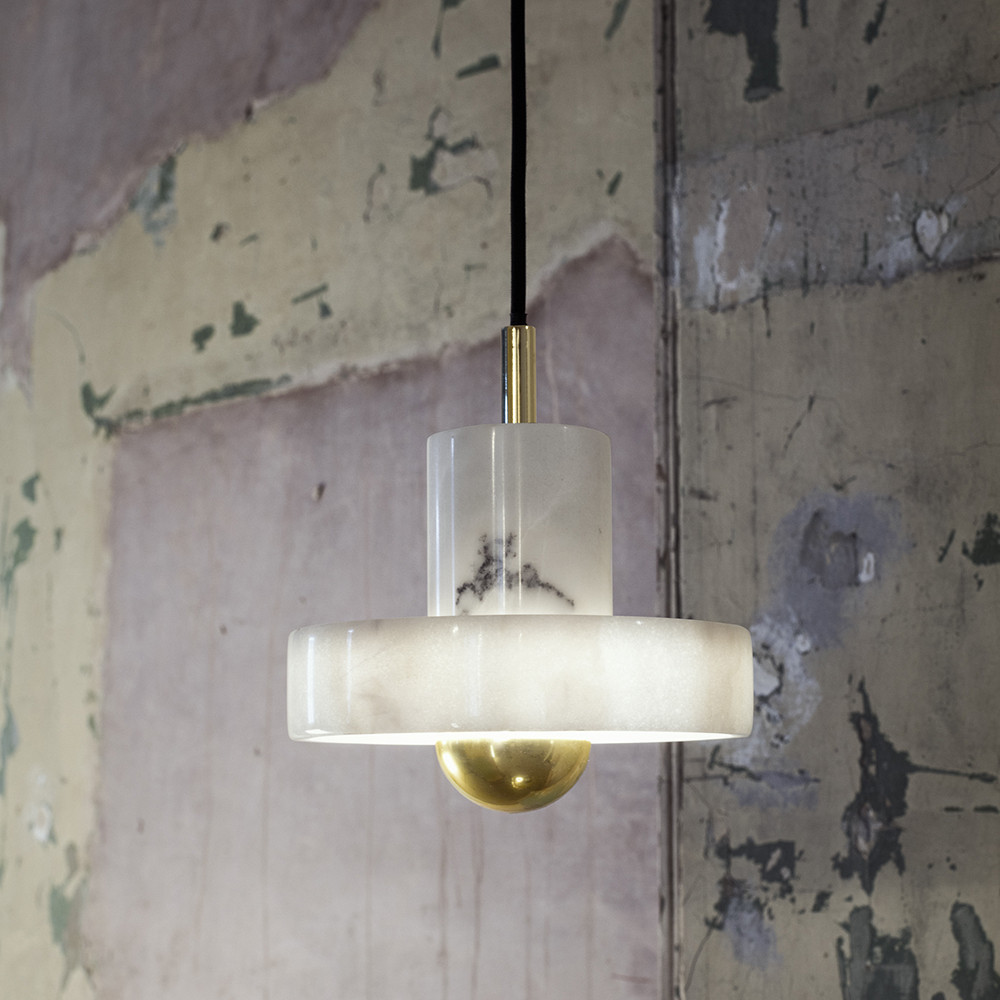 Stone Pendant Light - TOM DIXONMade from marble, the timeless material is transformed into a striking design item, suspended in a kitchen, living room or entrance hall. £191.25 from £225.